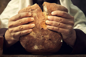 hands holding bread