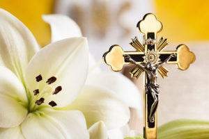gold Jesus cross and white flower